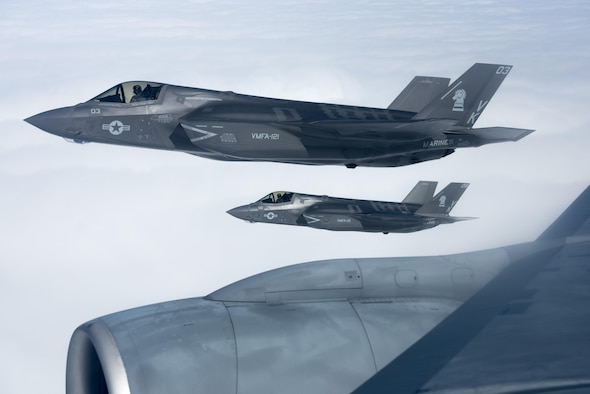 U.S. Marine Corps F-35B Lightning IIs from Marine Fighter Attack Squadron 121, fly in formation with a KC-135 Stratotanker from the 909th Air Refueling Squadron March 14, 2017, over the Pacific Ocean. The two units conducted aerial refueling for the first time within the 909th's area of operation. (U.S. Air Force photo by Senior Airman John Linzmeier)
