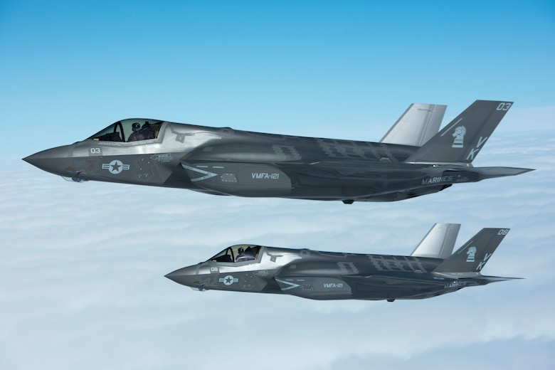 U.S. Marine Corps F-35B Lightning IIs from Marine Fighter Attack Squadron 121 fly in formation next to a U.S. Air Force KC-135 Stratotanker from the 909th Air Refueling Squadron March 14, 2017, over Pacific waters. The F-35B is a fifth-generation fighter, which is the world's first operational supersonic short takeoff and vertical landing aircraft. (U.S. Air Force photo by Senior Airman John Linzmeier)
