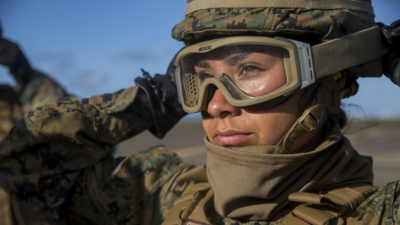 Lance Cpl. Loren Brooks, a motor transport specialist with Transportation Services Company, Combat Logistics Battalion 3, adjusts her goggles during external lift training at Landing Zone West Field at Marine Corps Air Station Kaneohe Bay, Hawaii, March 8, 2017. Landing support specialists with TSC partnered with Marine Heavy Helicopter Squadron 463 to conduct external load lifts. This training improves proficiency for the pilots when moving supplies while Marines on the ground conditioned themselves to safely prepare dual and single load lifts.
