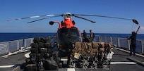 U.S. Coast Guard Cutter Spencer crew members secure the helicopter to the flight deck of the ship Saturday, Feb. 18, 2017. The Spencer returned from a 74-day Eastern Pacific ocean patrol after seizing $92 million in cocaine.(U.S. Coast Guard photo by Petty Officer 2nd Class Timothy Midas)
