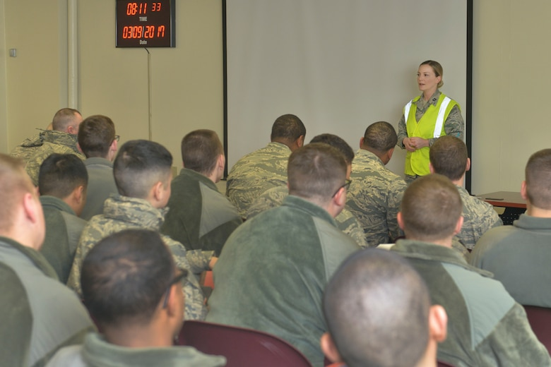 Capt. Marilyn Smith, 5th Force Support Squadron manpower and personnel flight commander, speaks with Airmen before deployment out-processing March 9, 2017. More than 400 Airmen from the 5th Bomb Wing recently deployed to the Middle East, in support of U.S. Central Command's Operation Inherent Resolve. (U.S. Air Force photo/Airman 1st Class Jessica Weissman)
