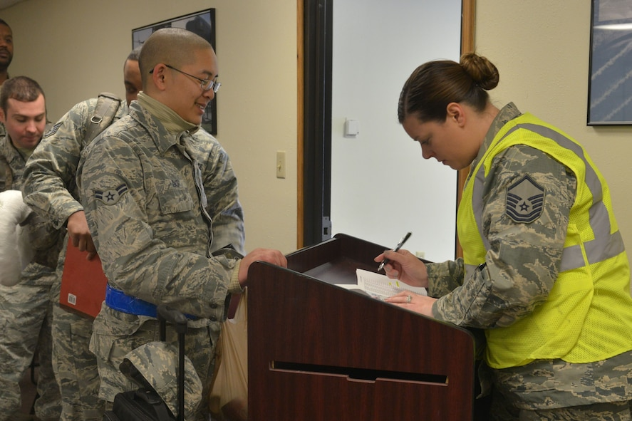 Master Sgt. Marlena Lugo Ruiz, 5th Force Support Squadron career development element NCO in charge, takes accountability during a deployment processing line at Minot Air Force Base, N.D., March 9, 2017.  (U.S. Air Force photo/Airman 1st Class Jessica Weissman)