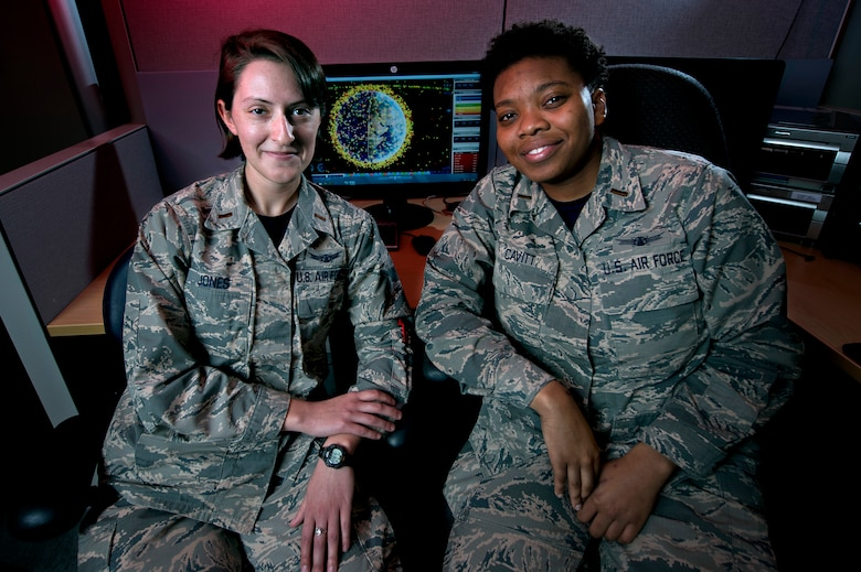 Second Lts. Ranell Cavitt and Maggie Jones, 3rd Space Experimentation Squadron, have been nearly inseparable since they arrived at Schriever Air Force Base, Sept. 30, 2015. They have only been separated professionally for a short time, during training, since their arrival and work closely together as Automated Navigation and Guidance Experiment in Local Space satellite mission planners and trainers. Their shared experience and passion for space and science helped build a friendship and camaraderie that appears like a life-long bond, though the pair met less than two years ago. (U.S. Air Force photo/Christopher DeWitt)