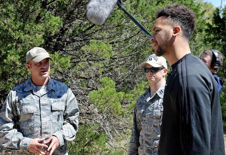 Kyle Anderson of the San Antonio Spurs gets a briefing on what security forces trainees experience during training at Joint Base San Antonio-Camp Bullis March 14.