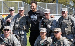 Kyle Anderson of the San Antonio Spurs poses with basic officer leadership course cadre at Joint Base San Antonio-Camp Bullis March 14.