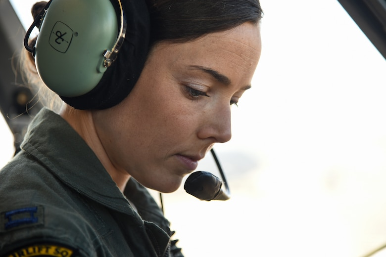 Capt. Jamie LaRivee, 21st Airlift Squadron C-17 Globemaster III pilot, simulates aircraft procedures at Travis Air Force Base, Calif., March 14, 2017. LaRivee's mother was in the first class of female cadets at the Air Force Academy. (U.S. Air Force photo by Senior Airman Sam Salopek)