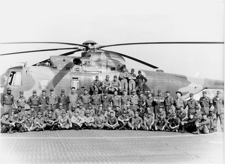 Members of the 58th Special Operations Squadron take a group photo in front of a Sikorsky SH-3 at Kirtland Air Force Base, New Mexico. In January 1993, the 377th Air Base Wing activated becoming the host unit for Kirtland while the 542nd became a tenant. The following year, the 542nd deactivated and the 58th SOW activated, becoming the wing we know today. (Courtesy Photo)