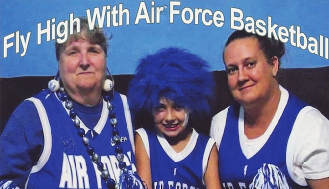 U.S. Air Force Academy supporters Bonnie Bonnin (left), her granddaughter Kayla (middle), and daughter Kim Williams, were featured on a 2014 Falcons basketball season billboard on Interstate 25 near Monument, Colorado. Carey Bonnin (not seen), his wife Bonnie, and Kim are Academy employees who have supported the school for decades as Falcons fans and cadet sponsors. (Courtesy photo)
