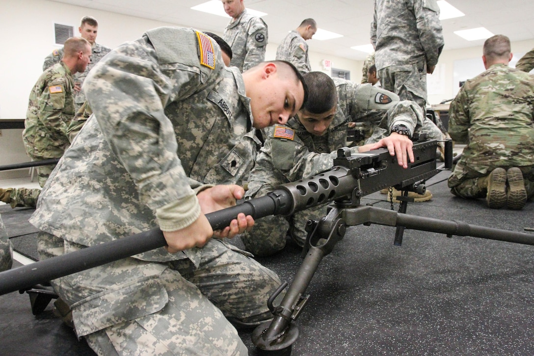 U.S. Army Reserve Soldiers with 79th Sustainment Support Command, assemble an M2 machine gun while participating in preliminary marksmanship training during Operation Cold Steel at Fort McCoy, Wis., March 12, 2017. Operation Cold Steel is the U.S. Army Reserve's crew-served weapons qualification and validation exercise to ensure that America's Army Reserve units and soldiers are trained and ready to deploy on short-notice and bring combat-ready and lethal firepower in support of the Army and our joint partners anywhere in the world. (U.S. Army Reserve photo by Staff Sgt. Debralee Best, 84th Training Command)