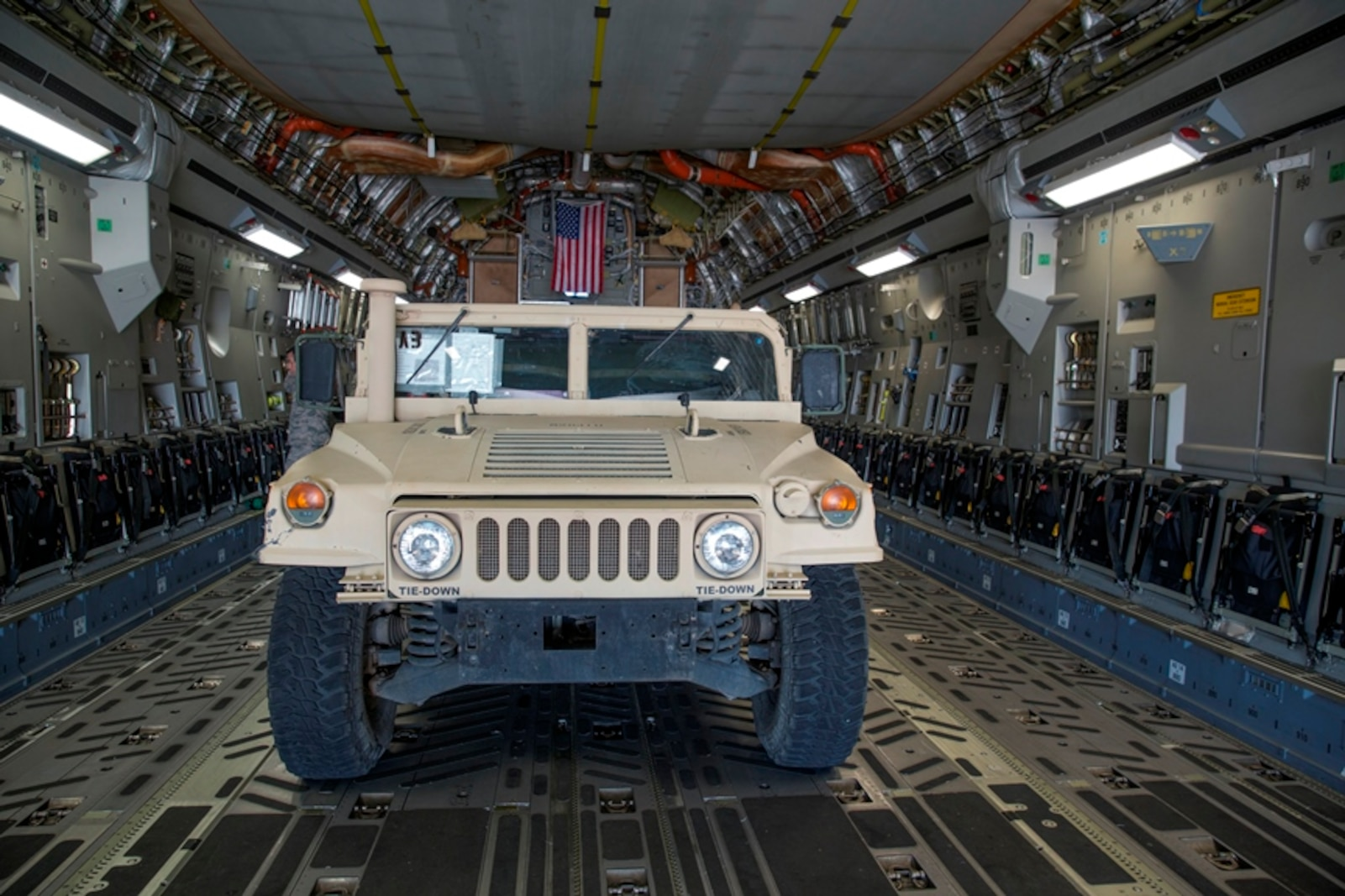 A Marine Corps High Mobility Multipurpose Wheeled Vehicle (HMMWV) is parked in the loading bay of an Air Force C-17 Globemaster III aircraft during Strategic Mobility Exercise on March Air Force Reserve Base, Calif., March 12, 2017. STRATMOBEX is a training exercise conducted by the 1st Marine Logistics Group in order to maintain readiness and sharpen skills needed to rapidly deploy personnel and equipment on a large scale.