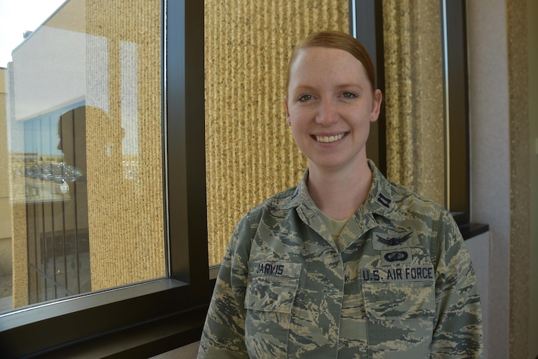 Capt. Kara Jarvis, 50th Space Wing Network Operations Group, Commander's Action Group chief, connects with her Irish-American heritage through her red hair at Schriever Air Force Base, Colorado, March 9, 2017.  Western Europe houses more redheads than anywhere else in the world, with approximately ten percent in Ireland.  (U.S. Air Force photo/Tech. Sgt. Sara Bishop)