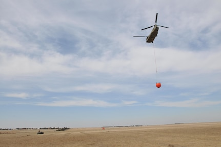 Aircrews from the 11th Expeditionary Combat Aviation Brigade (ECAB) flew three CH-47 Chinooks helicopters, specially outfitted with Bambi Bucket equipment, to assist in the relief efforts of those who were affected by the wildfires, Mar. 9. The 11th ECAB is a subordinate unit under the Army Reserve Aviation Command (ARAC). The Army Reserve Aviation Command's mission is to provide mission command to all assigned units in order to deploy trained and ready Expeditionary Combat Aviation Brigades and Theater Fixed Wing Battalions to a specified area of operations in support of the combatant commander. Its capabilities include air assault, air movement, aeromedical evacuation, casualty evacuation and civil support operations. Army Reserve units have capabilities critical to DSCA response, including search and rescue, aviation, engineer, transportation, medical and communications support. The Army Reserve has Soldiers and equipment in more than 1,100 communities across the nation allowing immediate respond to local emergencies. We stand with our nation in support of our neighbors and our primary concern is their safety and well-being. (U.S. Army Photo by Capt. Matthew Roman, Army Reserve Aviation Command Public Affairs Officer)