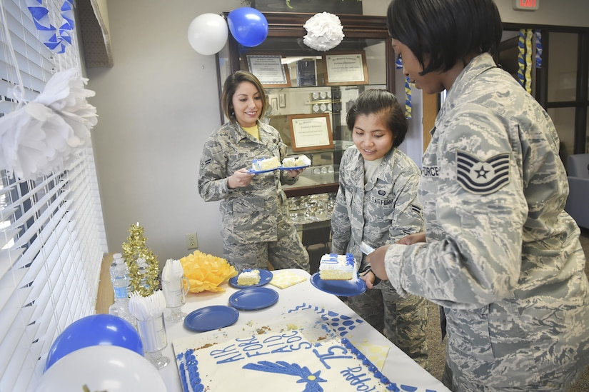 Tech. Sgt. Eva Simmons, right, 628th Force Support Squadron readiness NCO in charge, serves cake to Airman 1st Class Vanessa Ortiz, left, and Airman 1st Class Lorelie Budioganon, center, both assigned to the 628th Force Support Squadron, during an event celebrating the 75th Anniversary of the Air Force Aid Society at the Airman and Family Readiness Center here, March 10, 2017. The AFAS is a private non-profit organization working to provide relief to Air force members and their families in financial distress and to assist in their pursuit of higher education goals. There are four charities that service members can donate to as part of the Air Force Assistance Fund campaign (AFAF). Those interested in the AFAF campaign have until April 14 to make pledges.