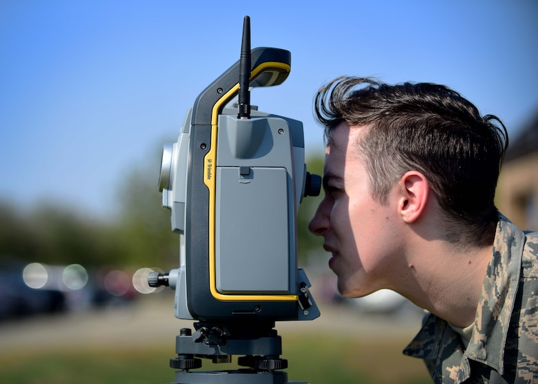 U.S. Air Force Airman 1st Class Ryan Mundt, 633rd Civil Engineer Squadron engineering technician, performs an optical site survey, at Joint Base Langley-Eustis, Va., March 9, 2017. Mundt is a member of the mapping section, which has more than 45,000 drawings that are kept and maintained, to include all on-base facilities and floor plans. (U.S. Air Force photo/Senior Airman Areca T. Bell)