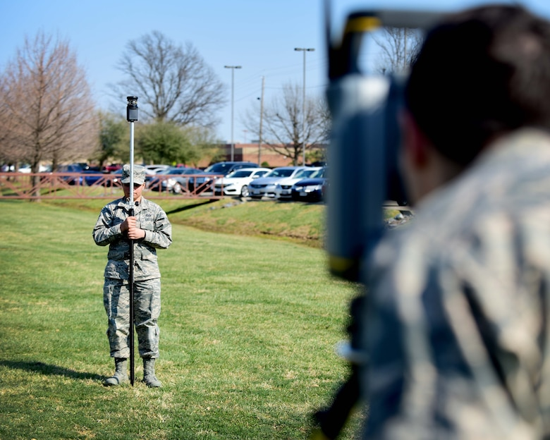 From left, U.S. Air Force Airman Gabrielle Victor and Airman 1st Class Ryan Mundt, 633rd Civil Engineer Squadron engineering technicians, prepare for an optical site survey, at Joint Base Langley-Eustis, Va., March 9, 2017. Victor and Mundt are members of the mapping section, which fulfills requests, such as finding appropriate locations for projects and estimating the resources needed for them. (U.S. Air Force photo/Senior Airman Areca T. Bell)