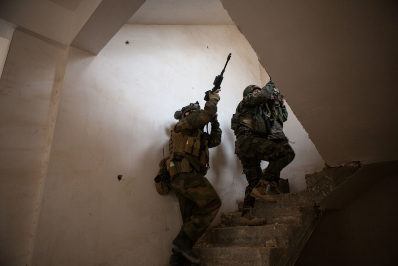 A Norwegian trainer moves through a building alongside Zeravani soldiers during training in military operations on urban terrain at Erbil, Iraq, Jan. 31, 2017. Norway is one of more than 60 coalition partners who are part of the Combined Joint Task Force-Operation Inherent Resolve building partner capacity mission dedicated to training Iraqi security forces. CJTF-OIR is the global coalition to defeat the Islamic State of Iraq and Syria. Army photo by Sgt. Josephine Carlson