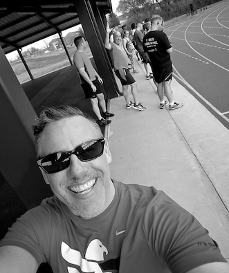 Christopher Parr, 932nd Airlift Wing Public Affairs specialist hams it up with fellow Group 1 members preparing to do sprints, on hated Wednesday, Feb. 22, 2017, Scott Air Force Base, Illinois. You can follow along with Parr's adventures in running by checking out his weekly blog in the commentaries section.  (U.S. Air Force photo by Christopher Parr)
