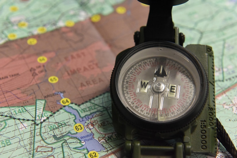 Airmen learned to read a map, use a compass and plot coordinates on the map using a protractor to execute land navigation during war skills training at McCrady Army National Guard Training Center, Eastover, South Carolina March 6, 2017. Airmen were required  to use land navigation to reach their destinations throughout the remainder of the training. Thirty members from Joint Base Charleston attended the weeklong war skills training that taught land navigation, combat casualty care, improvised explosive device identification procedures, hand-to-hand combat skills and team building exercises.