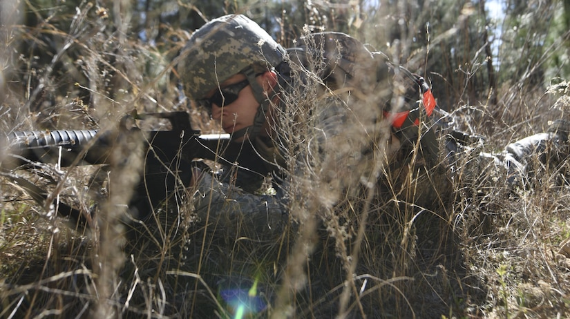 Staff Sgt. Dylan M. Churby, 628th Logistics Readiness Squadron vehicle operator, sights his weapon from the prone position during a field training exercise at McCrady Army National Guard Training Center, Eastover, South Carolina March 9, 2017. Churby secured a linear danger area during the exercise which required a group of Airmen to navigate to a specific destination and deliver recently learned combat medical care to a simulated casualty. Thirty Airmen from Joint Base Charleston attended the weeklong war skills training that taught land navigation, combat casualty care, improvised explosive device identification procedures, hand-to-hand combat skills and team building exercises.