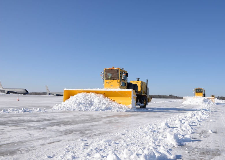 Airmen from Pease Snow Removal Team plow the flight line here, March 15. The team is composed of 20 Airmen and civilians working 12 hour shifts around the clock to clear more than 90 acres of the flight line as well as the roads and sidewalks around the base.