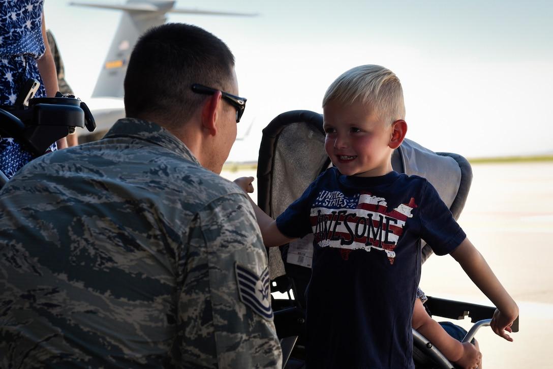 An Airman greets a little boy