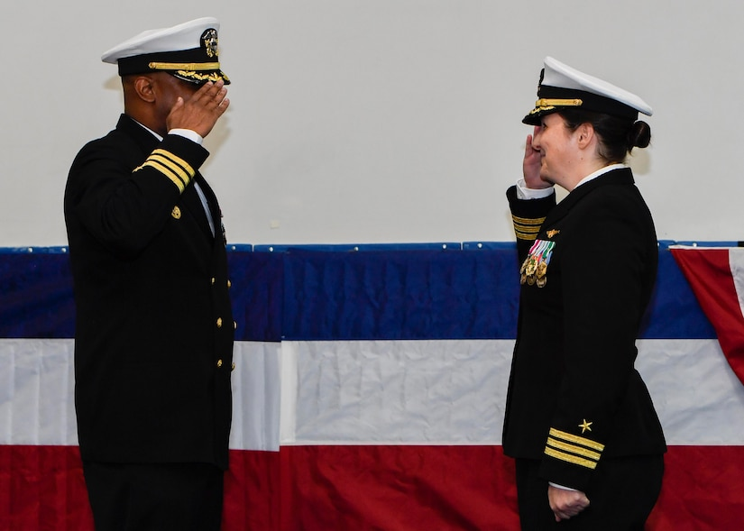U.S. Navy Cdr. Teresa Ferry, left, relieves U.S. Navy Cdr. Stephen Jones, right, as Naval Operational Support Center Charleston commanding officer during a change of command ceremony at the Bowman Center on the Joint Base Charleston-Weapons Station, March 4, 2017. Ferry is arriving from Navy Reserve Forces Command while Jones is retiring after 20 years of service.