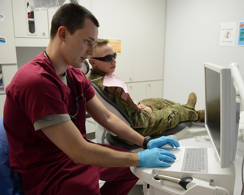 U.S. Army Capt. Tyler Oatmen, U.S. Army Dental Command dentist, explains a treatment plan to a patient at the Tignor Dental Clinic at Joint Base Langley-Eustis, Va., March 10, 2017. Technicians and dentists see approximately 7,000 Soldiers annually within the 28-chair clinic. (U.S. Air Force photo/Staff Sgt. Teresa J. Cleveland)