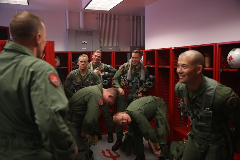 """Maj. Gen. Mark Wise, commanding general of 3rd Marine Aircraft Wing, encourages pilots from Marine Fighter Attack Squadron (VMFA) 232 """"Red Devils"""" before their departure from Marine Corps Air Station Miramar, Calif., March 11. Marine Fighter Attack Squadron (VMFA) 232 """"Red Devils,"""" the oldest Marine fighter attack squadron, will spend six months training in the Asia-Pacific region and northern America.  (U.S. Marine Corps photo by Sgt. David Bickel/Released)"""