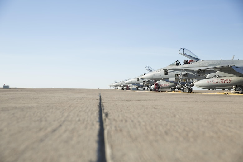 """Several F/A-18C Hornets with Marine Fighter Attack Squadron (VMFA) 232 """"Red Devils"""" rest on the flight line prior to taking off from Marine Corps Air Station Mirimar, Calif., March 11. Marine Fighter Attack Squadron (VMFA) 232 """"Red Devils,"""" the oldest Marine fighter attack squadron, will spend six months training in the Asia-Pacific region and northern America.  (U.S. Marine Corps photo by Sgt. David Bickel/Released)"""