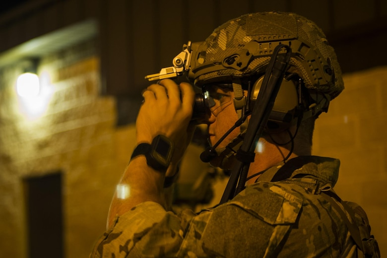Senior Airman John Nipp, an explosive ordnance disposal journeyman with the 1st Special Operations Civil Engineer Squadron, checks his night-vision goggles before training at Hurlburt Field, Fla., March 9, 2017. EOD Airmen cleared more than a mile of roadways and disabled several simulated caches of explosive ordnance during training. (U.S. Air Force photo by Airman 1st Class Joseph Pick)