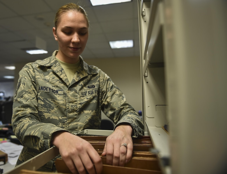 Airman 1st Class Briana Anderson, a re-enlistment and extension technician with the 1st Special Operations Force Support Squadron, sorts a re-enlistment file at the Military Personnel Flight on Hurlburt Field, Fla., March 14, 2017. Anderson is responsible for processing and reviewing re-enlistment, extension and bonus paperwork for Air Commandos. (U.S. Air Force photo by Airman 1st Class Joseph Pick)