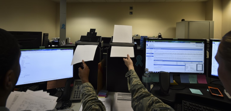 Airman 1st Class Adrian Basfield, left, and Briana Anderson, re-enlistment and extension technicians with the 1st Special Operations Force Support Squadron, scan documents at the Military Personnel Flight on Hurlburt Field, Fla., March 14, 2017. Personnelists are responsible for ensuring that Air Commandos have the correct paperwork to remain ready to execute operations. (U.S. Air Force photo by Airman 1st Class Joseph Pick)