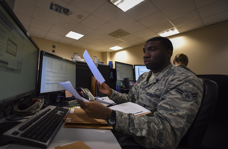 Airman 1st Class Adrian Basfield, a re-enlistment and extension technician with the 1st Special Operations Force Support Squadron, reviews re-enlistment folders for accuracy and discrepancies at the Military Personnel Flight on Hurlburt Field, Fla., March 14, 2017. Personnelists with the 1st SOFSS are broken into five sections: assignments, force management, promotions, re-enlistment and extensions, and retirement and separations. (U.S. Air Force photo by Airman 1st Class Joseph Pick)