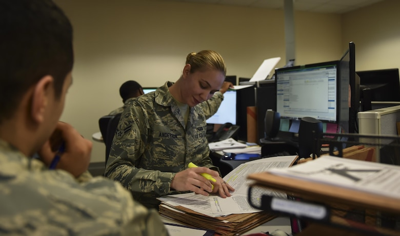 Airman 1st Class Briana Anderson, a re-enlistment and extension technician with the 1st Special Operations Force Support Squadron, assists a customer at the Military Personnel Flight on Hurlburt Field, Fla., March 14, 2017. Anderson is responsible for processing and reviewing re-enlistment, extension and bonus paperwork for Air Commandos. (U.S. Air Force photo by Airman 1st Class Joseph Pick)