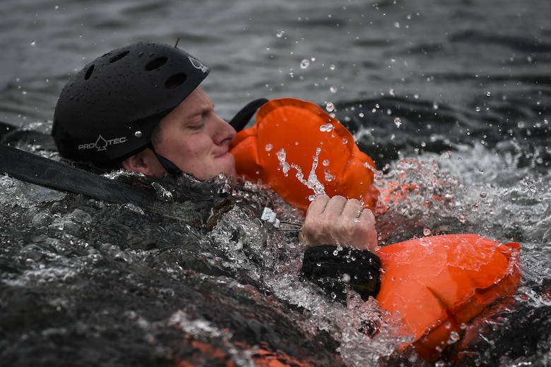 Staff Sgt. Josh Clements, a special missions aviator with the 4th Special Operations Squadron, releases from a simulated parachute during water survival training at Hurlburt Field, Fla., March 14, 2017. Aircrew must participate in combat, emergency parachute and water survival training tri-annually. (U.S. Air Force photo by Airman 1st Class Joseph Pick)