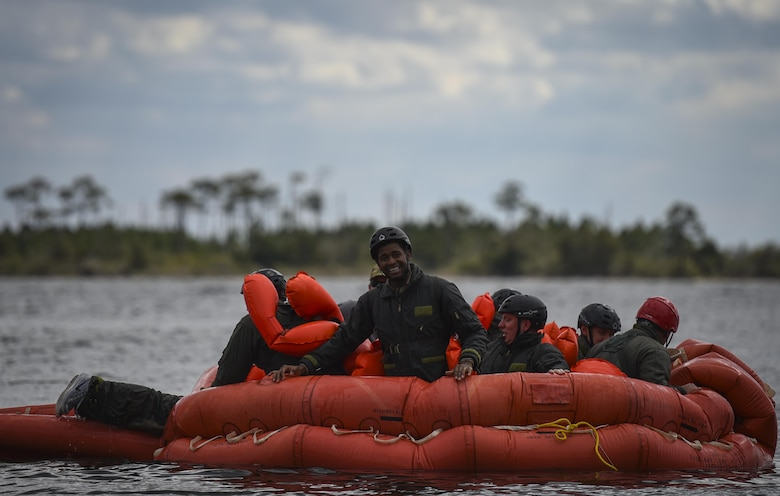Aircrew members participate in water survival training at Hurlburt Field, Fla., March 14, 2017. Water survival training is required for aircrew tri-annually to maintain proficiency on skill sets such as canopy disentanglement, parachute drop and drag, and life raft boarding. (U.S. Air Force photo by Airman 1st Class Joseph Pick)