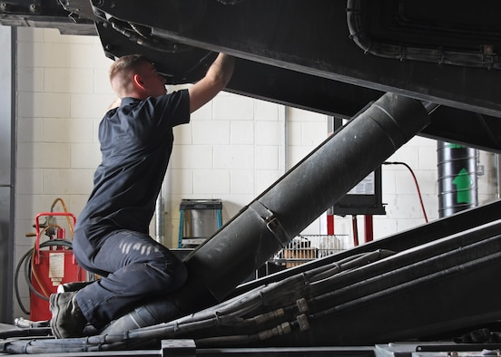 U.S. Air Force Staff Sgt. Michael Daniel, the material handling equipment NCO in charge with the 379th Expeditionary Logistics Readiness Squadron Vehicle Management Flight, repairs a hydraulic cylinder on a 25K loader at Al Udeid Air Base, Qatar, March 13, 2017. Hydraulic equipment uses hydraulic pressure to raise and lower weights that would otherwise be extremely difficult to use without the use of the 25K loaders, the Airmen at Al Udeid would be unable to load heavy cargo into aircraft such as the C-17 Globemaster III. (U.S. Air Force photo by Senior Airman Miles Wilson)