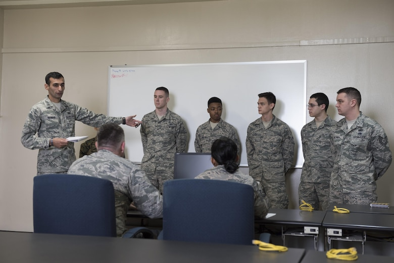 U.S. Air Force 1st Lt. Qadeer Rheman, 18th Contracting Squadron contracting officer, conducts a commander briefing during an operational contracting support joint exercise Jan. 24, 2017, at Camp Foster, Japan. During the scenario, officers and finance agents briefed the commander about what they could provide, the amount of money they could request, and asked the commander for their priorities. (U.S. Air Force photo by Senior Airman Omari Bernard)