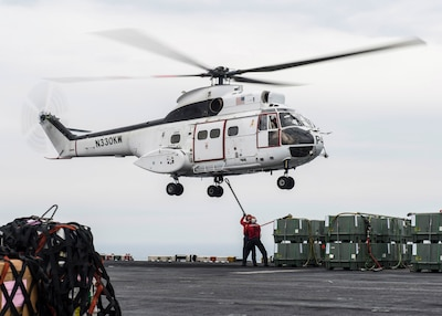 U.S. 5TH FLEET AREA OF OPERATIONS (March 11, 2017) Aviation Ordnanceman Jaymes Cudjo, from Harker Heights, Texas, and Aviation Ordnanceman 2nd Class Dillon Hays, from Kansas City, Mo., attach supplies to an SA-330J Puma helicopter aboard the amphibious assault ship USS Makin Island (LHD 8) during a vertical replenishment. Makin Island is deployed in the U.S. 5th Fleet area of operations in support of maritime security operations designed to reassure allies and partners, and preserve the freedom of navigation and the free flow of commerce in the region. (U.S. Navy photo by Mass Communication Specialist 3rd Class Devin M. Langer)