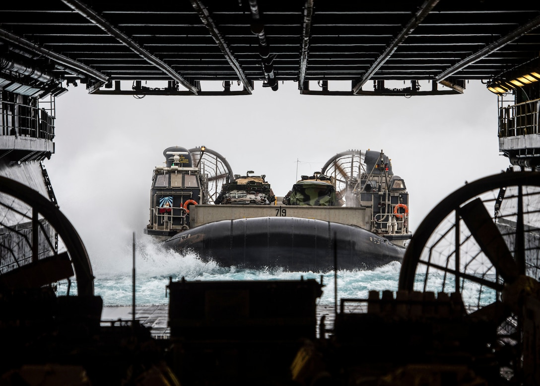 U.S. 5TH FLEET AREA OF OPERATIONS (Feb. 18, 2107) Landing Craft, Air Cushion 79, assigned to Assault Craft Unit 5, approaches the well deck of the amphibious assault ship USS Makin Island (LHD 8). Makin Island is deployed in the U.S. 5th Fleet area of operations in support of maritime security operations designed to reassure allies and partners and preserve the freedom of navigation and the free flow of commerce in the region. (U.S. Navy photo by Mass Communication Specialist 3rd Class Devin M. Langer)