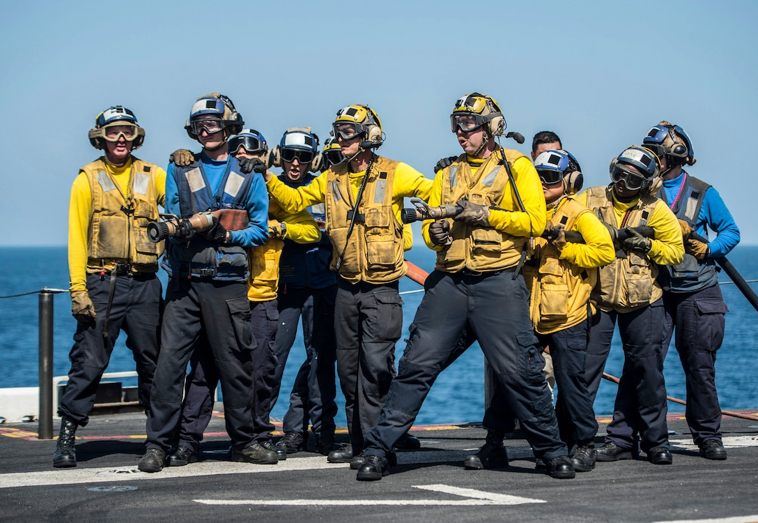 U.S. 5TH FLEET AREA OF OPERATIONS (March 8, 2017) Sailors fight a simulated fire during an aviation fire drill aboard the amphibious assault ship USS Makin Island (LHD 8). Makin Island is deployed in the U.S. 5th Fleet area of operations in support of maritime security operations designed to reassure allies and partners, and preserve the freedom of navigation and the free flow of commerce in the region. (U.S. Navy photo by Mass Communication Specialist 3rd Class Devin M. Langer)