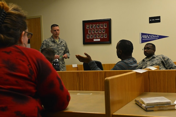 U.S. Air Force Master Sgt. Jason Harlan, 20th Equipment Maintenance Squadron munitions operations noncommissioned officer in charge, center left, listens to a question from one of the attendees of the Shaw Philosophy Society at Shaw Air Force Base, S.C., March 14, 2017. The group meets every second Tuesday of the month to discuss philosophical ideas such as moral dilemmas and ethics. (U.S. Air Force photo by Airman 1st Class Destinee Sweeney)