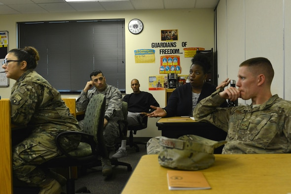 An attendee of the Shaw Philosophy Society discusses her views at Shaw Air Force Base, S.C., March 14, 2017. Attendees discussed the ideas of good and evil using superhero and supervillain characters and common themes in comic books as examples. (U.S. Air Force photo by Airman 1st Class Destinee Sweeney)
