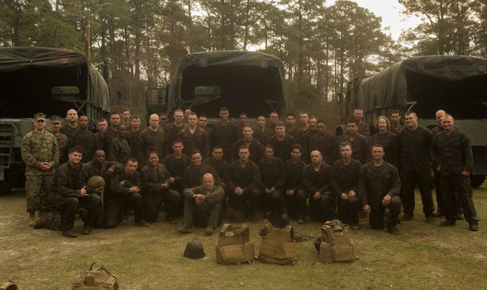Marines gather for a celebratory photo after the completion of the endurance course at the Battle Skills Training School on Camp Lejeune, N.C., March 10, 2017. The course is designed to improve and test Marines on their ability to work together through challenging obstacles. The Marines are with 8th Engineer Support Battalion. (U.S. Marine Corps photo by Pfc. Abrey Liggins)
