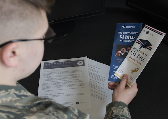 Airman Dalton Shank, 5th Bomb Wing Public Affairs broadcast journalist apprentice, reads pamphlets on the Montgomery GI Bill and the Post-9/11 GI Bill at Minot Air Force Base, N.D., March 10, 2017. A higher education can be achieved with little to no cost by utilizing the services offered through the Air Force. (U.S. Air Force photo/Airman 1st Class Alyssa M. Akers)
