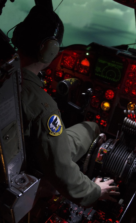 Maj. Craig Clark, 69th Bomb Squadron pilot, tilts the B-52H Stratofortress in the B-52 weapons system trainer during a simulated flight at Minot Air Force Base, N.D., March 8, 2017. The WST has undergone numerous modifications through its lifetime to ensure similarities stay the same between the simulator and the aircraft. (U.S. Air Force photo/Airman 1st Class Alyssa M. Akers)