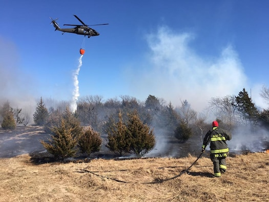 Tech. Sgt. Kyle Rollins, 22nd Civil Engineer Squadron firefighter, contains a wildfire March 7, 2016, in Reno County, Kan. Eighteen firefighters from McConnell Air Force Base responded to the fire to aid the local fire departments. (Courtesy photo)