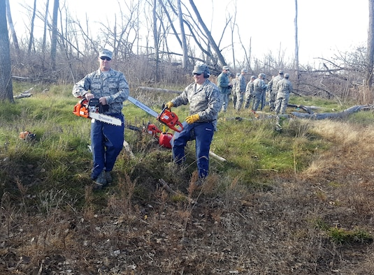 185th Air Refueling Wing Civil Engineers Iowa Air National Guard in Sioux City, Iowa use chain saws that are part of domestic operations debris clean up package, to cut fallen trees at an Army National Guard training site adjacent the Sioux City Airport, during the November, 2016 training weekend. (185th ARW photo/released)