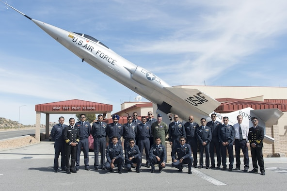 Indian Air Force Test Pilot School staff members and students consisting of 14 pilots and engineers, pose for a group photo in front of the NF-104 outside the U.S. Air Force Test Pilot School March 8. The visit to TPS was part of a two-day tour of Edwards AFB. (U.S. Air Force photo by Kyle Larson)