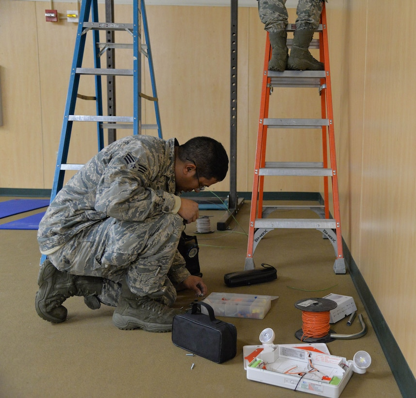 Senior Airman Diego Rojas Rodriguez, 341st Civil Engineer Squadron electrical systems journeyman, browses his electrical equipment March 13, 2017, at Malmstrom Air Force Base, Mont. The electrical team is replacing more than 12,000 lamps on base at nine facilities with LEDs, and they have already completed three of the nine buildings. (U.S. Air Force photo/Airman 1st Class Daniel Brosam)